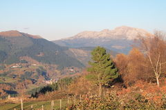 Aramaio, Basque Country. View of Aramaio with Mount Udalaitz in the background, from Krutzeta, in autumn; Araba, Basque Country Stock Images