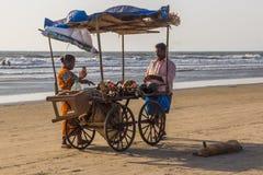 ARAMBOL BEACH, GOA, INDIA - FEBRUARY 23, 2017: Coconuts for sale. At flea market on Arambol beach at sunset in Goa, India on February 23, 2017 Stock Image