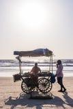 ARAMBOL BEACH, GOA, INDIA - FEBRUARY 23, 2017: Coconuts for sale. At flea market on Arambol beach at sunset in Goa, India on February 23, 2017 Royalty Free Stock Images