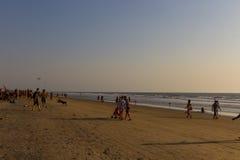 ARAMBOL BEACH, GOA, INDIA - FEBRUARY 23, 2017: Flea market on Ar. Ambol beach at sunset in Goa, India on February 23, 2017. People are walking on beach Royalty Free Stock Photos