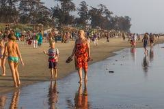 ARAMBOL BEACH, GOA, INDIA - FEBRUARY 23, 2017: Flea market on Ar. Ambol beach at sunset in Goa, India on February 23, 2017. People are walking on beach Stock Photography