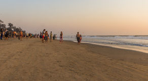 ARAMBOL BEACH, GOA, INDIA - FEBRUARY 23, 2017: Flea market on Ar. Ambol beach at sunset in Goa, India on February 23, 2017. People are walking on beach Royalty Free Stock Photo
