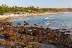 Arambol beach. People walk along sandy beach before sunset. Arambol, Goa, India Stock Photography