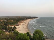 Arambol beach after sunset. Beautiful place on North Goa, India. View from the mountain after sunset Stock Photo