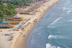 Arambol Beach. View from the sky, from  above, aerophoto, point. Of view. View of the beach. Long beautiful beach, top view. People walk on the beach, relax on Stock Photos