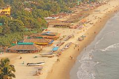 Arambol Beach. View from the sky, from  above, aerophoto, point. Of view. View of the beach. Long beautiful beach, top view. People walk on the beach, relax on Royalty Free Stock Photo