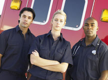Aramedics in front of an ambulance. Portrait of paramedics standing in front of an ambulance Royalty Free Stock Images