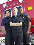 Aramedics in front of an ambulance Stock Image