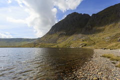 Aran Fawddwy and Llyn Dyfi. Llyn Dyfi, source of the River Dyfi which sits below the summit of Aran Fawddwy Royalty Free Stock Images