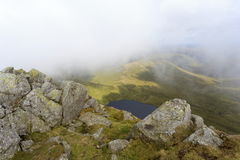 Aran Fawddwy and Llyn Dyfi. Llyn Dyfi, source of the River Dyfi which sits below the summit of Aran Fawddwy Stock Images