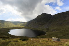 Aran Fawddwy and Llyn Dyfi. Llyn Dyfi, source of the River Dyfi which sits below the summit of Aran Fawddwy Stock Image