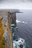 Aran Islands Cliffs. Rainy Day. Cliff of Don Aengus, Inishmore, Aran Islands, Ireland Stock Photo