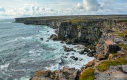 The scenic cliffs of Inishmore, Aran Islands, Ireland. The Aran Islands are 3 rocky isles guarding the mouth of Galway Bay, in western Ireland Royalty Free Stock Photography
