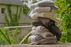 Aran knit heavy wool socks. Irish wool chunky knit ribbed winter socks in a pretty rural Irish setting Stock Photography