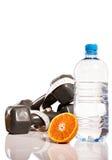 Arance, pesi e botte di acqua Fotografia Stock