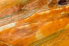 Arancia, Brown e granito lucidato bianco fotografie stock libere da diritti