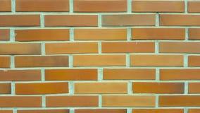 Arancia del fondo della carta da parati del cemento della pietra del mattone Immagini Stock