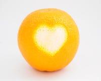 Arancia e cuore maturi Immagine Stock