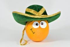 Arancia in un cappello Immagini Stock