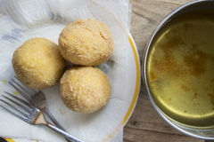 Arancine fried in boiling oil Stock Photography