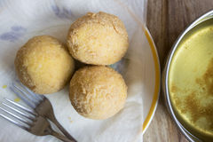Arancine fried in boiling oil. Street food : fried sicilian rice balls or arancini Royalty Free Stock Images
