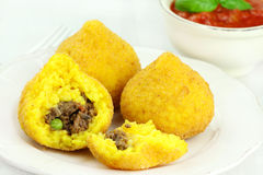 Arancini. Deep fried stuffed rice balls typical of Sicily Royalty Free Stock Photos