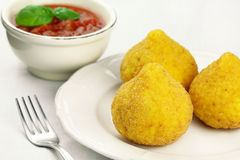 Arancini. Deep fried stuffed rice balls typical of Sicily Stock Photos