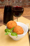 Arancini. Sicilian arancini on a wooden table Royalty Free Stock Photography