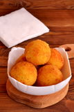 Arancini balls on a plate and on cutting board Stock Photos