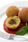Arancini, bolas de arroz frito Imágenes de archivo libres de regalías