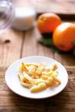 Arancini candied orange straps. On plate Royalty Free Stock Images