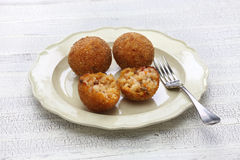 Arancini di riso, italian risotto rice balls. Arancini di riso, fried risotto rice balls, italian sicilian food Royalty Free Stock Images