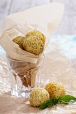 Arancini fried rice balls with herbs. In paper Royalty Free Stock Image