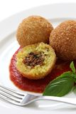 Arancini, fried rice balls. Italian cuisine Royalty Free Stock Images
