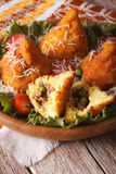 Arancini with meat and peas close-up on a plate. vertical Stock Photography