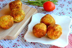 Arancini photo. Fried rice balls on a plate. Fried rice balls recipe. Rice arancini Stock Photos