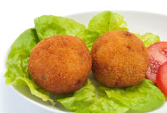 Arancini of rice. With salad and tomato Stock Photo
