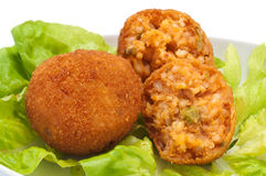 Arancini of rice. With salad Stock Photography