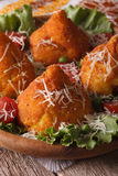Arancini rice balls with meat and cheese close-up. Vertical Royalty Free Stock Photography