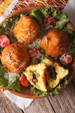 Arancini rice balls with meat close-up on a plate. vertical top Royalty Free Stock Image