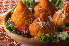 Arancini rice balls with meat and parmesan close-up. horizontal. Arancini rice balls with meat and parmesan close-up on a plate. horizontal Stock Images
