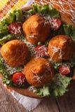 Arancini rice balls with meat and parmesan closeup. vertical top Stock Image