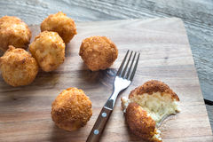 Arancini - rice balls with mozzarella. On the wooden board Royalty Free Stock Image
