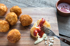 Arancini - rice balls with mozzarella. On the wooden board Royalty Free Stock Images