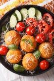 Arancini rice balls with parmesan closeup. Vertical top view Royalty Free Stock Photography