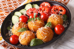 Arancini rice balls with parmesan and fresh vegetables. Horizont Royalty Free Stock Image