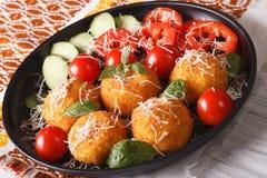 Arancini rice balls with parmesan and fresh vegetables. Horizont Royalty Free Stock Image