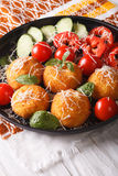 Arancini rice balls with parmesan and fresh vegetables. vertical Stock Photography