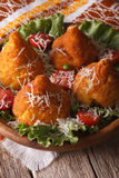 Arancini rice balls stuffed with meat and parmesan close-up. ver Stock Images