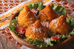Arancini rice balls stuffed with meat and parmesan closeup. hori Royalty Free Stock Photo